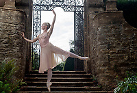BNPS.co.uk (01202) 558833.<br /> Pic: ZacharyCulpin/BNPS<br /> <br /> Principal dancer with The Royal Ballet, Anna Rose O'Sullivan limbers up before taking to the stage in the stunning grounds of the 500 year old  Athelhampton House. Anna was taking part in a fundraising ballet show at the Tudor Manor House in the Dorset countryside.