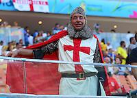 An England fan in fancy dress soaks up the atmosphere ahead of kick off