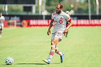 LAKE BUENA VISTA, FL - JULY 13: Nick DeLeon #18 of Toronto FC runs toward the ball during a game between D.C. United and Toronto FC at Wide World of Sports on July 13, 2020 in Lake Buena Vista, Florida.