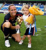 USWNT captain (3) Christie Rampone poses with her daughter, Rylie and the tournament trophy after the finals of the Peace Queen Cup.  The USWNT defeated Canada, 1-0, at Suwon World Cup Stadium in Suwon, South Korea.