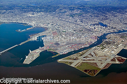 aerial photograph Port of Oakland, downtown Oakland, Alameda naval airstation, Emeryville and Berkeley, California