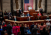 Speaker of the United States House of Representatives Nancy Pelosi (Democrat of California) calls for new members to raise their hands to be sworn in on the opening day of the 117th Congress at the U.S. Capitol in Washington, DC on January 03, 2021. <br /> CAP/MPI/RS<br /> ©RS/MPI/Capital Pictures