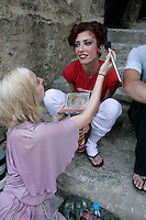 Royal Ballet dancer Mara Galeazzi having her make-up touched before a performance