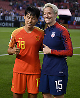 Cleveland, Ohio - Tuesday June 12, 2018: Han Peng, Megan Rapinoe during an international friendly match between the women's national teams of the United States (USA) and China PR (CHN) at FirstEnergy Stadium.