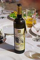 On the dining table, bottle of wine Misno Vino 2004, Zilavka grape variety, Obiteljski Podrum Rozic. Restaurant Restoran Rondo on the Rondo Square Historic town of Mostar. Federation Bosne i Hercegovine. Bosnia Herzegovina, Europe.
