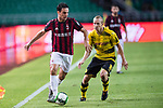 AC Milan Midfielder Giacomo Bonaventura (L) fights for the ball with Borussia Dortmund Midfielder Sebastian Rode (R) during the International Champions Cup 2017 match between AC Milan vs Borussia Dortmund at University Town Sports Centre Stadium on July 18, 2017 in Guangzhou, China. Photo by Marcio Rodrigo Machado / Power Sport Images