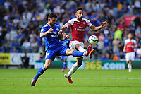 Sean Morrison of Cardiff City battles with Pierre-Emerick Aubameyang of Arsenal during the Premier League match between Cardiff City and Arsenal at Cardiff City Stadium in Cardiff, Wales, UK. September 2, 2018