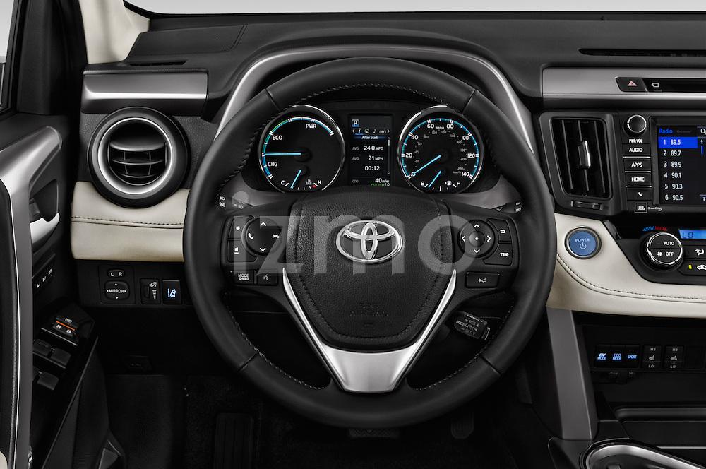 Car pictures of steering wheel view of a 2018 Toyota RAV4 Hybrid-Limited-4x4 5 Door SUV Steering Wheel