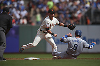 SAN FRANCISCO, CA - SEPTEMBER 29:  Joe Panik #12 of the San Francisco Giants turns a double play at second base against the Los Angeles Dodgers during the game at AT&T Park on Saturday, September  29, 2018 in San Francisco, California. (Photo by Brad Mangin)