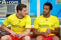 Tottenham Hotspur players Mousa Dembele and Jan Vertonghen of Belgium start on the bench