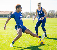 ORLANDO, FL - JANUARY 20: Crystal Dunn #19 of the USWNT steals the ball during a training session at the practice fields on January 20, 2021 in Orlando, Florida.