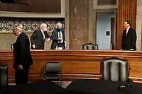 """United States Senator Patrick Leahy (Democrat of Vermont) elbow bumps US Senator John Cornyn (Republican of Texas) while former US Deputy Attorney General Rod Rosenstein looks on before a Senate Judiciary Committee hearing to discuss the FBI's """"Crossfire Hurricane"""" investigation on Wednesday, June 3, 2020.<br /> Credit: Greg Nash / Pool via CNP/AdMedia"""