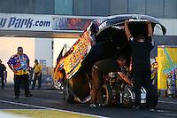 May 31, 2013; Englishtown, NJ, USA: NHRA crew members for funny car driver Tony Pedregon during qualifying for the Summer Nationals at Raceway Park. Mandatory Credit: Mark J. Rebilas-