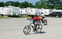 Boys ride bikes in FEMA trailer park, 2006