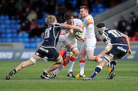 20130310 Copyright onEdition 2013©.Free for editorial use image, please credit: onEdition..Ernst Joubert of Saracens is tackled by Andy Powell of Sale Sharks as Tom Holmes of Sale Sharks supports during the LV= Cup semi final match between Sale Sharks and Saracens at the Salford City Stadium on Sunday 10th March 2013 (Photo by Rob Munro)..For press contacts contact: Sam Feasey at brandRapport on M: +44 (0)7717 757114 E: SFeasey@brand-rapport.com..If you require a higher resolution image or you have any other onEdition photographic enquiries, please contact onEdition on 0845 900 2 900 or email info@onEdition.com.This image is copyright onEdition 2013©..This image has been supplied by onEdition and must be credited onEdition. The author is asserting his full Moral rights in relation to the publication of this image. Rights for onward transmission of any image or file is not granted or implied. Changing or deleting Copyright information is illegal as specified in the Copyright, Design and Patents Act 1988. If you are in any way unsure of your right to publish this image please contact onEdition on 0845 900 2 900 or email info@onEdition.com