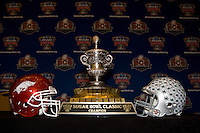 A picture of Ohio State and Arkansas helmets is shown on the table before Head Coaches' Press Conference at Marriott at the Convention Center in New Orleans, Louisiana on January 3rd, 2011.