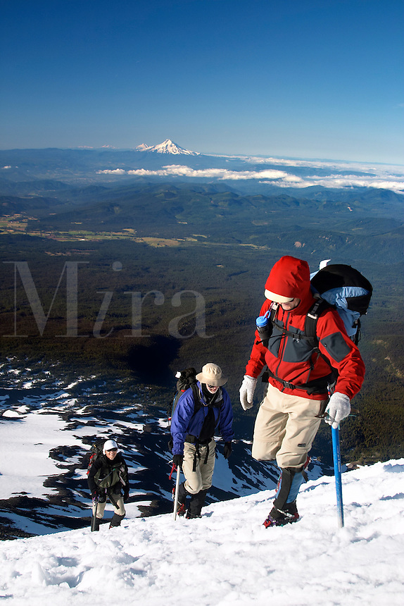 Two men and a woman climbing up snow on Mount Adams, Yakima County, Cascade  Mountains, Washington, USA