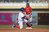 Jose Rodriguez (12) of the Kannapolis Cannon Ballers slides into second base ahead of the tag by Brett Wisely (5) of the Charleston RiverDogs at Atrium Health Ballpark on July 4, 2021 in Kannapolis, North Carolina. (Brian Westerholt/Four Seam Images)