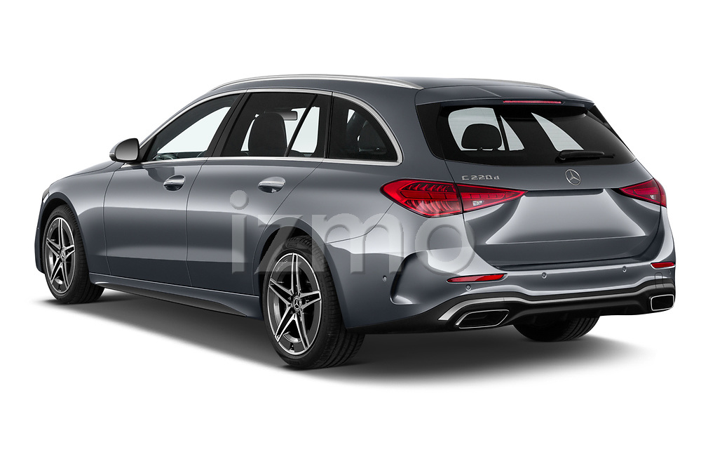 Car pictures of rear three quarter view of 2022 Mercedes Benz C-Class AMG-Line 5 Door Wagon Angular Rear