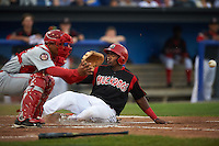 Batavia Muckdogs outfielder Yuniel Ramirez (43) slides into home behind catcher Luis Vilorio (25) during a game against the Auburn Doubledays on September 5, 2015 at Dwyer Stadium in Batavia, New York.  Batavia defeated Auburn 6-3.  (Mike Janes/Four Seam Images)