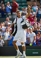 01-07-13, England, London,  AELTC, Wimbledon, Tennis, Wimbledon 2013, Day seven,Juan Martin Del Potro (ARG)<br /> waves to the public when he leaves the court<br /> <br /> <br /> <br /> <br /> Photo: Henk Koster