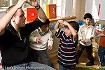 Education Preschool 3-5 year olds male teacher singing song with hand motions interacting with boy horizontal