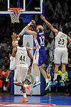 Real Madrid´s Gustavo Ayon and Sergio Llull and Anadolu Efes´s Nenad Krstic during 2014-15 Euroleague Basketball Playoffs second match between Real Madrid and Anadolu Efes at Palacio de los Deportes stadium in Madrid, Spain. April 17, 2015. (ALTERPHOTOS/Luis Fernandez)