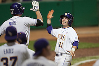 LSU Tigers third baseman Tyler Hanover #11 scores the tying run in the bottom of the 10th inning against the Mississippi State Bulldogs at the NCAA baseball game on March 16, 2012 at Alex Box Stadium in Baton Rouge, Louisiana. LSU defeated Mississippi State 3-2 in 10 innings. (Andrew Woolley / Four Seam Images)..