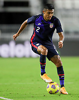 FORT LAUDERDALE, FL - DECEMBER 09: Julian Araujo #2 of the United States gets after a ball during a game between El Salvador and USMNT at Inter Miami CF Stadium on December 09, 2020 in Fort Lauderdale, Florida.