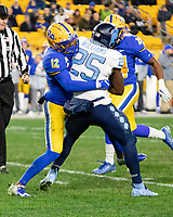 Pitt defensive back Paris Ford (12) tackles North Carolina running back Javonte Williams. The Pitt Panthers defeated the North Carolina Tarheels 34-27 in overtime in the football game on November 14, 2019 at Heinz Field, Pittsburgh, Pennsylvania.