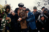 """Bucharest, Romania<br /> December 1989<br /> <br /> A burial of a victim killed in the violence that deposed the former Romanian leader Nicolae Ceausescu.<br /> <br /> The week-long series of violence that overthrew the Communist regime of Nicolae Ceausescu, ended in a trial and execution of Ceausescu and his wife Elena by firing squad. Romania was the only Eastern Bloc country to violently overthrow its Communist regime or to execute its leaders.<br /> <br /> The Romanian populace was dissatisfied with the Communist regime and leader Ceausescu's economic and development policies were blamed for the country's shortages and widespread poverty. The powerful secret police (Securitate) controlled what was essentially a police state. Ceausescu was not pro-Soviet but """"independent"""" on foreign policy. He imitated the hard-line, megalomania, and personality cults of communist leaders like North Korea's Kim Il Sung."""