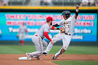 Syracuse Chiefs shortstop Jason Martinson (5) tags out Carlos Sanchez (13) of the Charlotte Knights at second base at BB&T BallPark on June 1, 2016 in Charlotte, North Carolina.  The Knights defeated the Chiefs 5-3.  (Brian Westerholt/Four Seam Images)