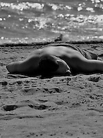 Max Dupain got this one first.  Here a sun worshipper on Ft Lauderdale Beach poses.