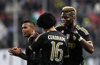 Calcio, Serie A: Frosinone vs Juventus. Frosinone, stadio Comunale, 7 febbraio 2016.<br /> Juventus' Juan Cuadrado, center, celebrates with teammate Paul Pogba, right, after scoring during the Italian Serie A football match between Frosinone and Juventus at Frosinone's Comunale stadium, 7 January 2016.<br /> UPDATE IMAGES PRESS/Isabella Bonotto