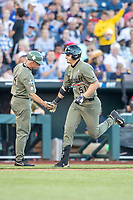 Vanderbilt Commodores outfielder JJ Bleday (51) is congratulated by head coach Tim Corbin (4) after hitting a home run against the Michigan Wolverines during Game 1 of the NCAA College World Series Finals on June 24, 2019 at TD Ameritrade Park in Omaha, Nebraska. Michigan defeated Vanderbilt 7-4. (Andrew Woolley/Four Seam Images)