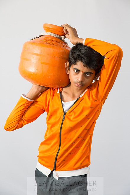 """Ashish Jathav, 16, collects 4-5 pots of water everyday from public taps in the drought-hit city of Latur. """"Our street has a government bore well but it has no water. It takes 2-3 hours to fill water and the traffic on the road makes it difficult to take water home."""""""