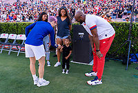 PASADENA, CA - AUGUST 4: Megan Rapinoe #15 fist bumps Kobe Bryant's daughter as he looks on during a game between Ireland and USWNT at Rose Bowl on August 3, 2019 in Pasadena, California.