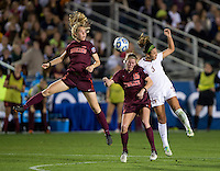 Nickolette Driesse (3) of Florida State goes up for a header with Ashley Meier (15) of Virginia Tech during the Women's College Cup semifinals at WakeMed Soccer Park in Cary, NC. Florida State defeated Virginia Tech, 3-2.