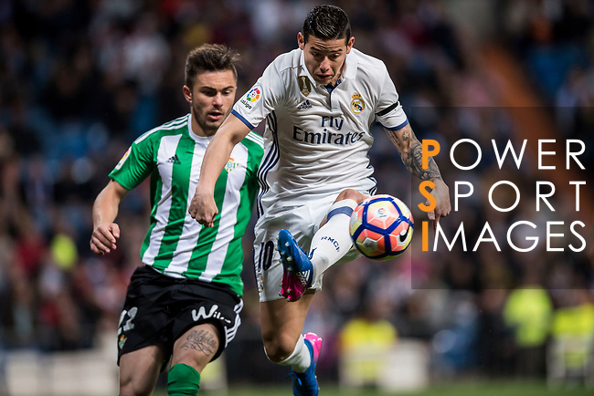 James Rodriguez (r) of Real Madrid fights for the ball with Alin Tosca of Real Betis during their La Liga match between Real Madrid and Real Betis at the Santiago Bernabeu Stadium on 12 March 2017 in Madrid, Spain. Photo by Diego Gonzalez Souto / Power Sport Images