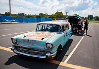 "Aug 9, 2020; Clermont, Indiana, USA; The 1957 Chevrolet wagon of Richie Crampton named the ""Sh*tbox of Doom"" is used to tow the NHRA top alcohol funny car of driver Jonnie Lindberg during the Indy Nationals at Lucas Oil Raceway. Mandatory Credit: Mark J. Rebilas-USA TODAY Sports"