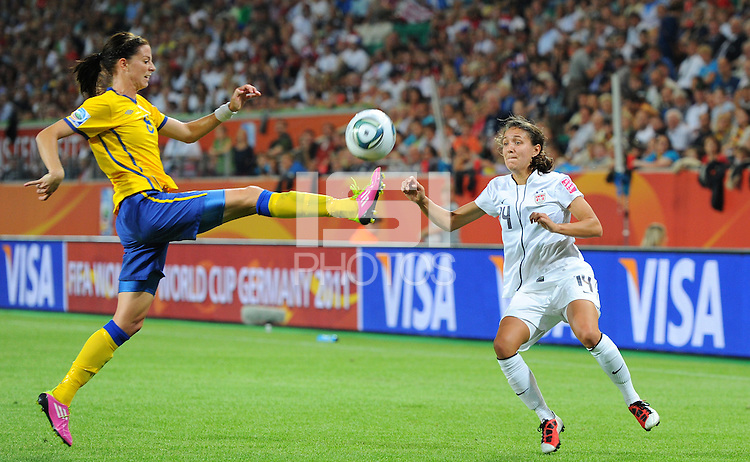 Stephanie Cox (r) of team USA and Lotta Schelin of team Sweden during the FIFA Women's World Cup at the FIFA Stadium in Wolfsburg, Germany on July 6thd, 2011.