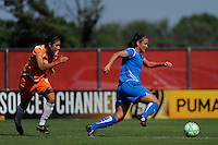 Christine Latham (7) of the Boston Breakers is chased by Yael Averbuch (10) of Sky Blue FC. Sky Blue FC defeated the Boston Breakers 1-0 during a Women's Professional Soccer match at Yurcak Field in Piscataway, NJ, on July 4, 2009.