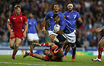 Glasgow 2014 Commonwealth Games<br /> Alatasi Tupou gets away from Will Harries.<br /> Wales v Samoa<br /> Ibrox Stadium<br /> <br /> 26.07.14<br /> ©Steve Pope-SPORTINGWALES
