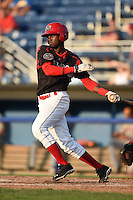 Batavia Muckdogs shortstop Javier Lopez (22) at bat during a game against the Connecticut Tigers on July 21, 2014 at Dwyer Stadium in Batavia, New York.  Connecticut defeated Batavia 12-3.  (Mike Janes/Four Seam Images)