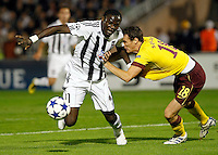 Partizan player Pierre Boya, left in action against Arsenal player Sebastiene Squillaci,  during  UEFA Champions league match in group H FC Partizan Belgrade Vs. Arsenal, London, Serbia, Monday, Sept. 28, 2010.  (Srdjan Stevanovic/Starsportphoto.com)