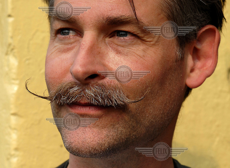 """Photographer Chris Stowers became fascinated with facial hair as he travelled around India. Commenting on the moustache he sports in this self-portrait, he says """"I was trying to grow an Imperial but it ended up more like a thin version of the Recumbent Banana."""""""