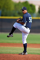 Seattle Mariners minor league pitcher Gabriel Saquilon #52 during an instructional league game against the San Diego Padres at the Peoria Sports Complex on October 6, 2012 in Peoria, Arizona.  (Mike Janes/Four Seam Images)