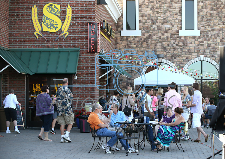 Crowds move through the Carson Mall during the 20th annual Taste of Downtown event in Carson City, Nev., on Saturday, June 15, 2013. The event features 44 local restaurants in a fundraiser for the Advocates to End Domestic Violence.<br /> Photo by Cathleen Allison