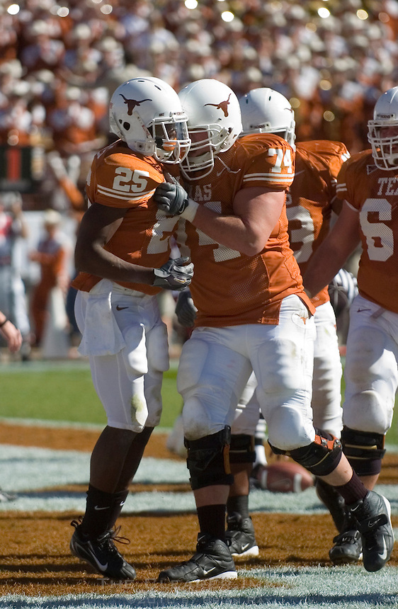 24 November 2006: Texas back Jamaal Charles (#25) is congratulated by teammate Adam Ulatoski (#74) after scoring a touchdown during the Longhorns game against the Texas A&M University Aggies at the Darrell K Royal Memorial Field in Austin, TX.