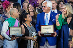 ARCADIA, CA - NOVEMBER 05: Arrogate jockey Mike Smith (L), trainer Bob Baffert (R), and the connections after they won the Breeders' Cup Classic during day two of the 2016 Breeders' Cup World Championships at Santa Anita Park on November 5, 2016 in Arcadia, California. (Photo by Alex Evers/Eclipse Sportswire/Breeders Cup)
